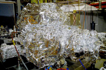 "SLAC National Accelerator Laboratory uses massive quantities of aluminum foil to perform ""bake out"" of their equipment. In a typical bake out, the equipment is blanketed in foil, wrapped with electrical heat tape, and then covered in foil again. Heat tape is used to heat the metal chamber just enough to loosen any residues that could cause trouble. The aluminum foil helps spread the heat evenly. 