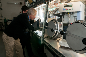 Argonne scientists Ira Bloom (front) and Javier Bareño prepare a sample of battery materials for Raman spectroscopy, which is used to gather information regarding the nature of the materials present in the sample. | Photo courtesy of Argonne National Laboratory.