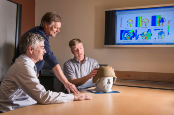 Paul Taylor, right, and John Ludwigsen, center, both researchers with Sandia's Terminal Ballistics Technology Department, and Corey Ford, a neurologist at the University of New Mexico's Health Sciences Center, discuss their research on traumatic brain injuries.   Photo by Randy Montoya