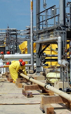 Savannah River Remediation employees work on the transfer line used to move grout to tanks 5 and 6.
