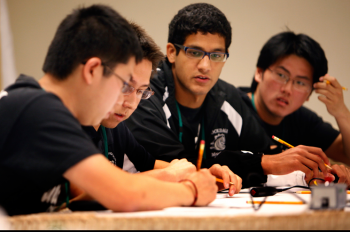 Members of the Los Alamos High School team, Los Alamos, New Mexico, concentrates on the answer to a question at the 2012 National Science Bowl in Washington D.C. on April 29, 2012.   Photograph by Dennis Brack, Office of Science