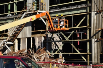This summer, workers began preparing K-31 for Wednesday's demolition by conducting asbestos abatement and removing the facility's exterior transite paneling.