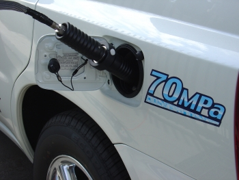 A hydrogen refueling dispenser locked onto a fuel cell electric vehicle.   Photo courtesy of National Renewable Energy Laboratory