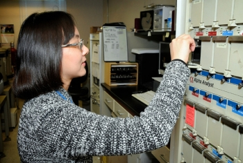 Hnin Khaing of WIPP Laboratories checks a radiological sample, similar to what would be analyzed in an event like the one simulated in the exercise to test national readiness to respond to a large radiological event.