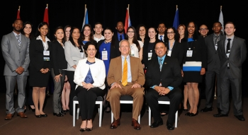 DOE Fellows gather with EM Lead Foreign Affairs Specialist Ana Han, front row, left to right, EM Acting Assistant Secretary David Huizenga, and Florida International University Applied Research Director Dr. Leonel E. Lagos at the Waste Management 2014 Conference.