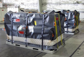 The new soft-sided overpack is placed for shipment for treatment and repackaging.
