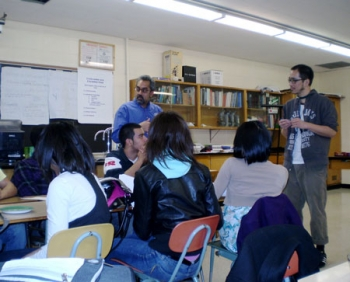 Vipin Gupta (left) and James Madison Academic Campus teacher Patrick Tao meet with students to discuss JMAC's solar challenge. | Photo courtesy of James Madison Academic Campus |