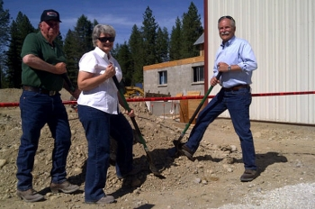 Dale and Sharon Borgford, small business owners in Stevens County, WA, break ground with Peter Goldmark, Washington State Commissioner of Public Lands. The pair brought more than 75 jobs to the area with help from DOE's State Energy Program and the U.S. Forest Service. | Photo courtesy of Washington DNR.