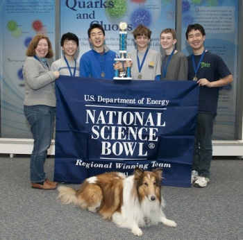 The Virginia winners: coach Sharon Webb, Alexander Yang, Steve Qian, Alec Brenner, Owen Gray, Zeming Lin and Ollie, the Virginia Regional Science Bowl puppy | Photo Courtesy of National Science Bowl