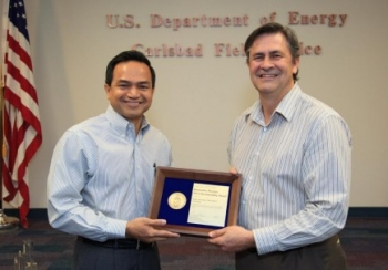 Department of Energy Carlsbad Field Office Site Operations Director Casey Gadbury (right) presents Farok Sharif, President and Project Manager for Nuclear Waste Partnership LLC, the management and operating contractor at the Waste Isolation Pilot Plant, with a 2012 DOE Sustainability Award during a recognition event at WIPP. More than 20 CBFO and contractor employees were recognized with sustainability awards in four categories.