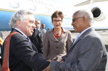 Upon arrival to Addis Ababa, Ethiopia, for the U.S.-Africa Energy Ministerial, U.S. Secretary of Energy Ernest Moniz is greeted on the tarmac by Ethiopian Minister of Water and Energy, Alemayehu Tegenu (right), and U.S. Ambassador to Ethiopia, Patricia Haslach (center). | Photo courtesy of the U.S. Embassy in Addis Ababa.