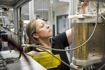 Engineer Whitney Jablonski works in the thermochemical lab at NREL's campus in Golden, Colorado. | Photo by Dennis Schroeder, NREL.