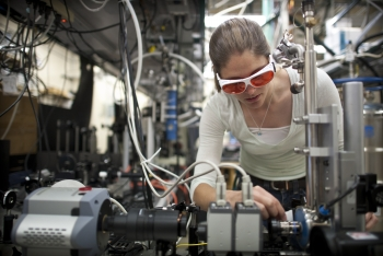 NREL researcher Kirsten Alberi works in the luminescence mapping laboratory at the Solar Energy Research Facility (SERF). Here she aligns a laser and sample to map the photoluminescence coming off the sample. | Photo by Dennis Schroeder, NREL.