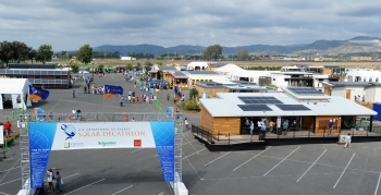 Crowds gather at the U.S. Department of Energy Solar Decathlon 2015 village in October. Today, the Energy Department announced the 16 collegiate teams selected to participate in the U.S. Department of Energy Solar Decathlon 2017 competition.   Photo by Thomas Kelsey, U.S. Department of Energy Solar Decathlon