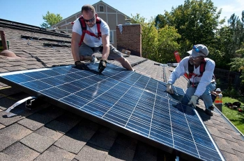 Home solar systems can save you energy and money.   Photo courtesy of Dennis Schroeder, NREL 22168.