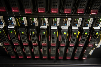 Computer racks in the high performance computing data center at the Energy Systems Integration Facility.  | Photo by Dennis Schroeder, National Renewable Energy Laboratory
