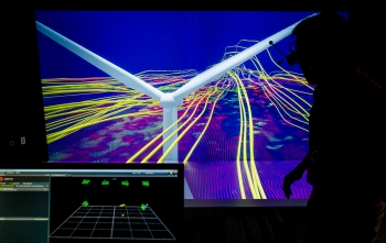National Renewable Energy Laboratory Senior Scientist  Kenny Gruchalla examines the velocity field from from a wind turbine simulation using a 3D model at the Energy Systems Integration Facility. | Photo by Dennis Schroeder, National Renewable Energy Laboratory