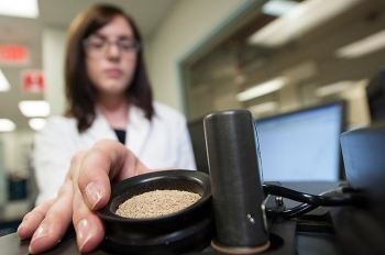 A researcher loads a biomass sample into spinning ring cup. Argonne National Laboratory has launched two online tools that assess the resource consumption and greenhouse gas emissions associated with biofuel production. | Photo courtesy of National Renewable Energy Laboratory