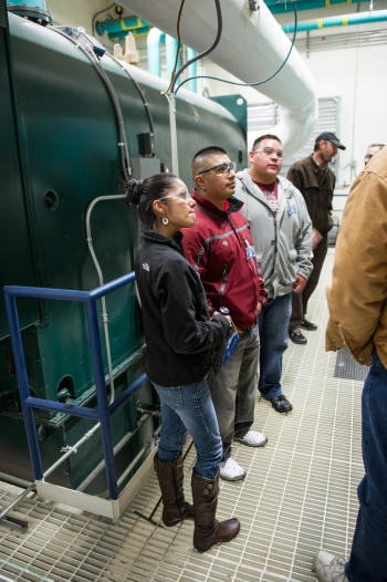 Touring NREL's Integrated Biorefinery Research Facility. From left to right: Reyna Banteah, Shaun Tsabetsaye, and Jeremy Laselute from the Zuni Pueblo Tribe. Photo by Dennis Schroeder, NREL