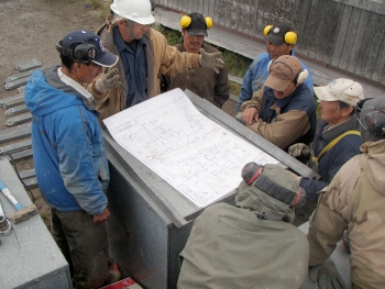 CWG community members review structural plans as part of their wind turbine training in Kwigillingok, AK. Photo from Intelligent Energy Systems, NREL 29205