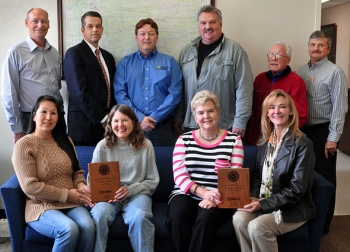 Oak Ridge's East Tennessee Technology Park award team is shown, front row, left to right, Veronica Hoffman, Betsy Brucken, Sherree Shaw, and Traci Hempen-Potter; back row, left to right, Jim McCague, Mark Whitney, Chuck Oldham, Moose Erickson, Leo Sain and Richard Frounfelker.