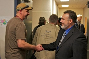 """Carlsbad Field Office Manager Joe Franco, right, exchanges greetings with Mark Long, Jr.,a Washington TRU Solutions LLC employee, at a WIPP all-hands meeting in February.""""WIPP is America's only and the world's best,"""" Franco said of the deep geologic repositoryfor nuclear waste."""