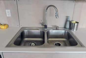 Fix leaky faucets to save $35 and 1,661 gallons of water. | Photo courtesy of Thomas Kelsey/U.S. Department of Energy Solar Decathlon