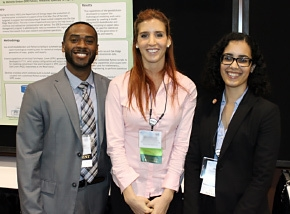 DOE Fellows gather in front of the student poster created by DOE Fellow Michelle Embon, center, at the Waste Management 2014 Conference.