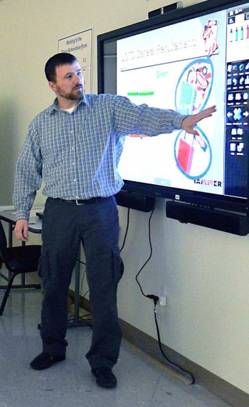 HAMMER instructor Michael Stordahl demonstrates the features available using a mondopad in a classroom.