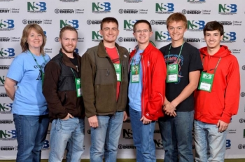 Calloway County High School's Mia Beth Morehead, coach, Landon Fike, Cody Bergman, Sam Morehead, Josh Betts, and Hudson Elliott from Murray, Kentucky, pose for a team photo during the 2014 National Science Bowl competition, Thursday, April 24, 2014, in Washington, DC.
