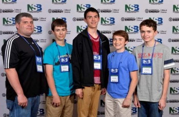 Lone Oak Middle School's Daniel Rushing, coach, Drew Schofield, David Dodd, David Perriello and Ethan Brown from Paducah, Kentucky, pose for a team photo during the 2014 National Science Bowl competition, Thursday, April 24, 2014, in Washington, DC.