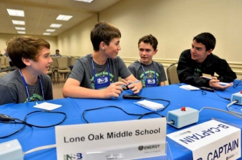 Lone Oak Middle School's Drew Schofield, David Dodd, David Perriello and Ethan Brown from Paducah, Kentucky, discuss a topic between rounds during the academic tournament at the 2014 National Science Bowl competition, Saturday, April 26, 2014, in  Washington, DC.