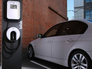 An electric vehicle uses a charging station. | Media photo from ECOtality
