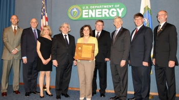 Energy Secretary Ernest Moniz, fourth from left, and Deputy Secretary Daniel Poneman, third from right, present the Secretary's Achievement Award to members of the Savannah River Site F-Tank Farm Closure Team. Team members pictured, left to right, are James Rush, William Levitan, Kathleen Martin, Linda Suttora, James Herbert, Kim Hauer, and Daniel Wood.