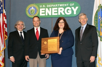 Members of the Salt Waste Processing Facility 2013 Renegotiation Team receive the Secretary's Achievement Award from Secretary Moniz, far left, and Deputy Secretary Poneman, far right. Team members pictured are Dean Hammonds and Melissa Rider.