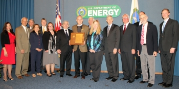 Salt Waste Disposal Technologies Team members receive the Secretary's Achievement Award from Secretary Moniz, seventh from left, and Deputy Secretary Poneman, fifth from right. Team members pictured, left to right, are Celia Aponte, Brent Gifford, William Brasel, Dr. Monica Regalbuto, Clifford Conner, Sarah Rocha, Dr. Bruce Moyer, Roy Schepens, Patricia Suggs, Dr. Leon Klatt, Dr. Thomas Burns, Professor Vincent Van Brunt, and Seth Campbell.