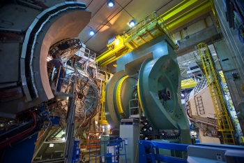The PHENIX detector at Brookhaven National Lab's Relativistic Heavy Ion Collider (RHIC), a type of particle accelerator, records many different particles emerging from RHIC collisions, including photons, electrons, muons, and quark-containing particles called hadrons. The detector is shown here in a disassembled condition during maintenance.   Photo courtesy of Brookhaven National Laboratory.