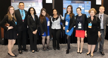 Pictured here are DOE Fellows with Florida International University Applied Research Center staff, including Dr. Leonel E. Lagos, second from left, and Dr. Yelena Katsenovich, second from right, at the Waste Management 2014 Conference Student Poster Competition.