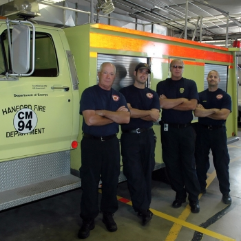 Hanford firefighters stand next to the 31-year-old chemical truck. Pictured, left to right, are Hanford Fire Lt. Robert Smith, Firefighter/Paramedic Kyle Harbert, Firefighter Don Blackburn and Capt. Sean Barajas.