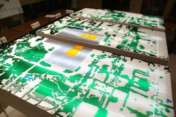 Shown at the Paducah Citizens Advisory Board office, this model depicts a 10-square-mile area around the Paducah site to a depth of several hundred feet. Yellow structures depict the site's four large uranium hexafluoride process buildings.