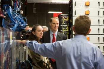 Assistant Secretary for the Office of Electricity Delivery and Energy Reliability Pat Hoffman and U.S. senator Ron Wyden from Oregon listen to Smart Grid Power Manager Kevin Whitener during a tour of PGE's Smart Power Center in Salem, Oregon. | Photo courtesy of Portland General Electric.