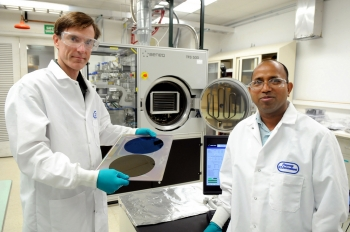 Argonne National Lab scientists Jeff Elam (left) and Anil Mane's work in nanocomposite charge drain coatings represents a significant breakthrough in the efforts to develop microelectromechanical systems, or MEMS. This new technology earned one of the 36 R&D 100 awards from R&D Magazine that the National Labs took home in 2013. | Image courtesy of Argonne National Laboratory.