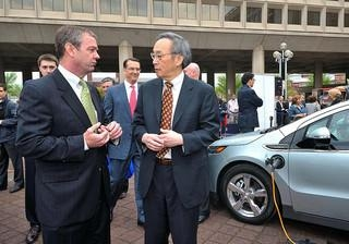 Secretary Chu, right, discusses electric vehicles with Brian Wynne, president of the Electric Drive Transportation Association, at an event in 2011.