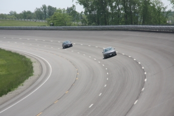 Track cars test gasoline with 45% derived from woody biomass.   Photo courtesy The Gas Technology Institute