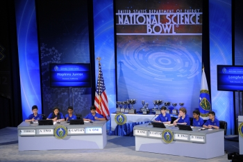 Longfellow Middle School from Falls Church, Virginia and Hopkins Junior High from Fremont, California, compete in the final academics round for the championship during the 2012 National Science Bowl in Washington, D.C.   Photograph by Jack Dempsey, U.S. Department of Energy.