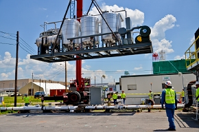 A crane lowers the carbon treatment system into place during construction.