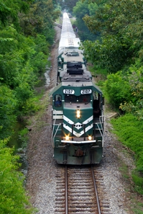 A P&L locomotive travels near Woodville Road, south of the Paducah site, with the waste shipment in tow.
