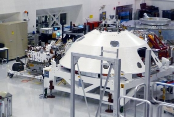 Dr. Robert C. Nelson took this photo of Curiosity, left, at NASA's Jet Propulsion Laboratory in Pasadena, Calif., in late November 2011. Shown here is the flight hardware assembled prior to shipment to Cape Canaveral Air Force Station in Florida for the launch.