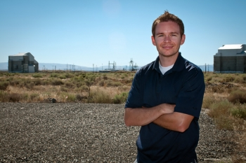 Cameron Salony, who will begin one-year Fellowship in Japan this summer, stands near Hanford's D and DR Reactors.