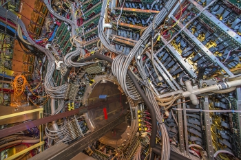 The Solenoidal Tracker at the Relativistic Heavy Ion Collider (RHIC) is a detector which specializes in tracking the thousands of particles produced by each ion collision at RHIC. Weighing 1,200 tons and as large as a house, STAR is a massive detector. It is used to search for signatures of the form of matter that RHIC was designed to create: the quark-gluon plasma. It is also used to investigate the behavior of matter at high energy densities by making measurements over a large area. | Photo courtesy of Brookhaven National Lab.